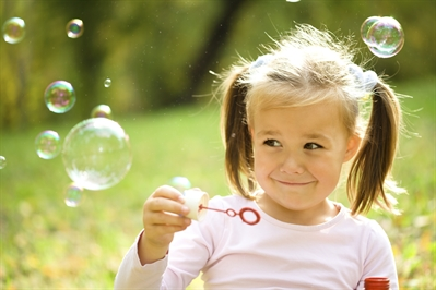 LifePuzl image Girl blowing bubbles